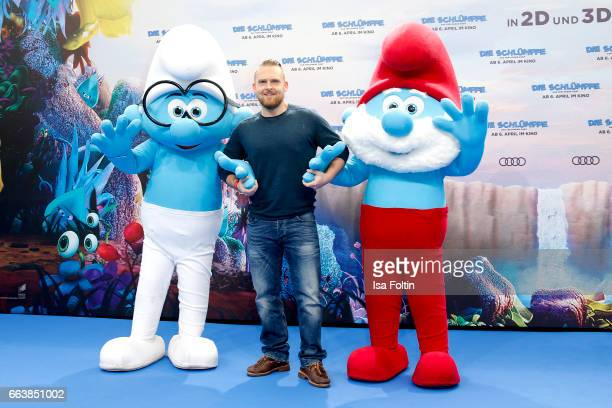 German actor Axel Stein with smurf 'Schlaubi' and smurf 'Papa Schlumpf' during the 'Die Schluempfe Das verlorene Dorf' premiere at Sony Centre on...