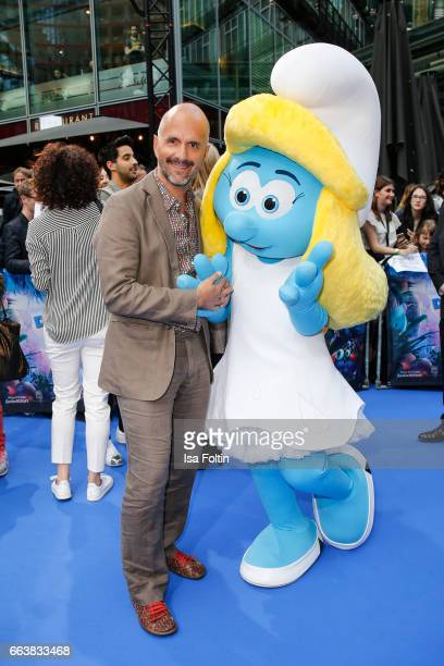 German actor Christoph Maria Herbst with smurf 'Schlumpfine' during the 'Die Schluempfe Das verlorene Dorf' premiere at Sony Centre on April 2 2017...