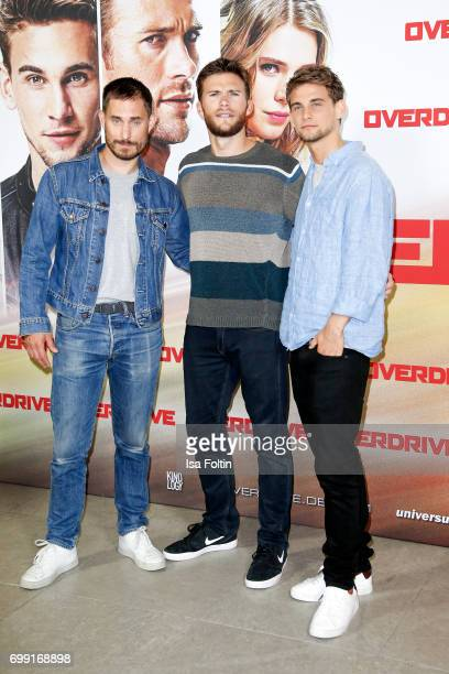 German actor Clemens Schick actor Freddie Thorp and US actor Scott Eastwood attend the 'Overdrive' Photo Call at Hotel De Rome on June 21 2017 in...