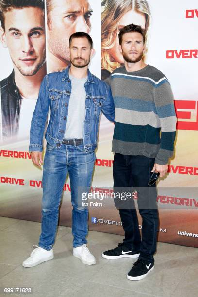 German actor Clemens Schick and US actor Scott Eastwood attend the 'Overdrive' Photo Call at Hotel De Rome on June 21 2017 in Berlin Germany
