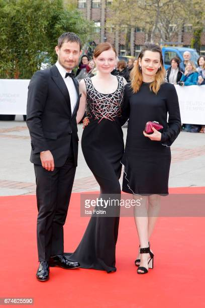 German actor Clemens Schick german actress Maria Dragus and swissfrench actress Ella Rumpf during the Lola German Film Award red carpet arrivals at...