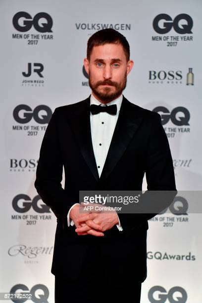 German actor Clemens Schick poses on the red carpet as he arrives for the GQ 'Men Of The Year' awards ceremony in Berlin on November 9 2017 / AFP...
