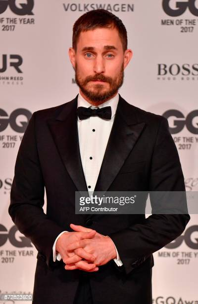 German actor Clemens Schick poses on the red carpet prior to the GQ 'Men Of The Year' awards ceremony in Berlin on November 9 2017 / AFP PHOTO / John...
