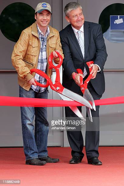 German actor director and comedian Michael 'Bully' Herbig and Matthias Esche head of the Bavaria film company open the bullyversum exhibition area at...