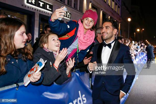 German actor Elyas MBarek arrives for the GQ Men of the year Award 2017 at Komische Oper on November 9 2017 in Berlin Germany