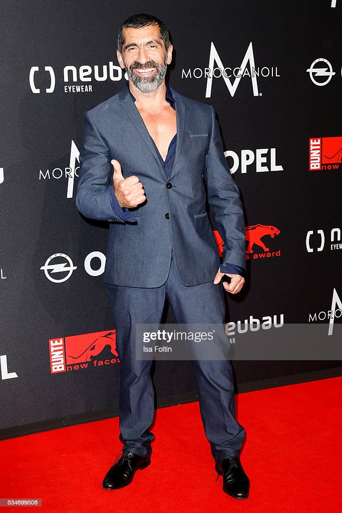 German actor Erdal Yildiz (suit by Porsche Design) attends the New Faces Award Film 2016 at ewerk on May 26, 2016 in Berlin, Germany.