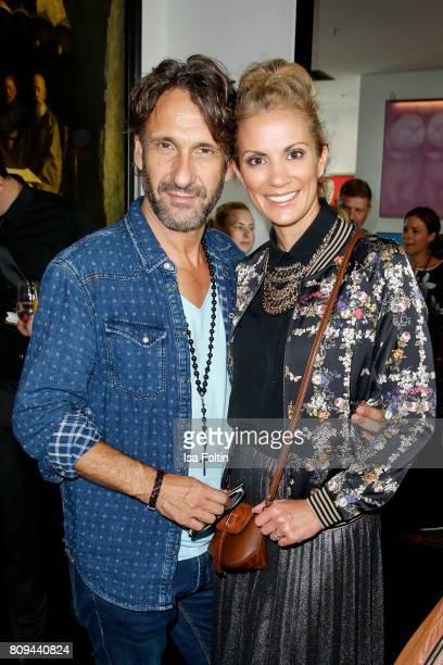 German actor FalkWilly Wild and German presenter Kerstin Linnartz attend the Thomas Sabo Press Cocktail during the MercedesBenz Fashion Week Berlin...
