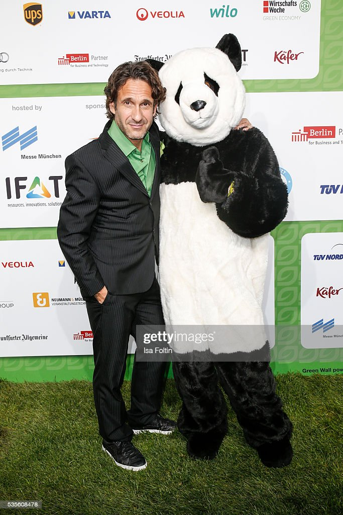 German actor Falk-Willy Wild with the Green Tec mascot attend the Green Tec Award at ICM Munich on May 29, 2016 in Munich, Germany.