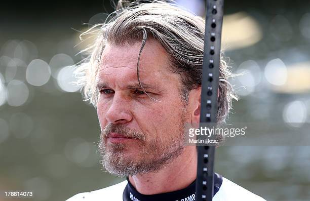 German actor Goetz Otto looks on before the Stand Up Paddling celebrity race at Magellan Terassen on August 16 2013 in Hamburg Germany