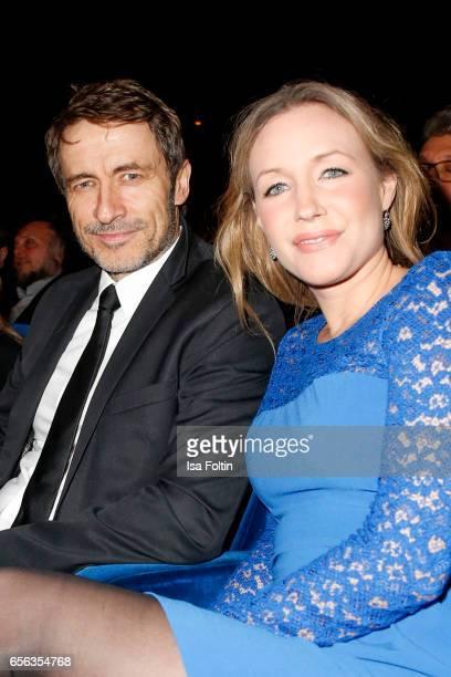 German actor Guido Broscheit and his girlfriend german actress Julika Wagner attend the Deutscher Hoerfilmpreis at Kino International on March 21...