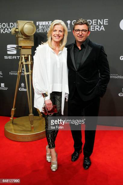 German actor Hans Sigl and his wife Susanne Kemmler arrive for the Goldene Kamera on March 4 2017 in Hamburg Germany