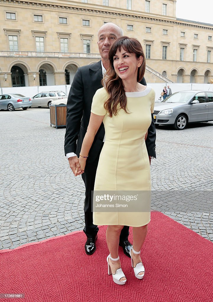 German actor Heiner Lauterbach (L) and his wife Viktoria Lauterbach arrive for the Bernhard Wicki Award ceremony at Munich film festival on July 4, 2013 in Munich, Germany.