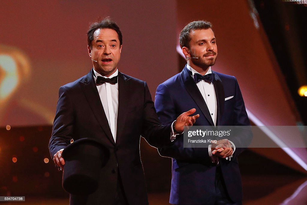 German actor Jan Josef Liefers and Edin Hasanovic (both wirth Jaeger-LeCoultre watch) during the Lola - German Film Award (Deutscher Filmpreis) 2016 - Show on May 27, 2016 in Berlin, Germany.