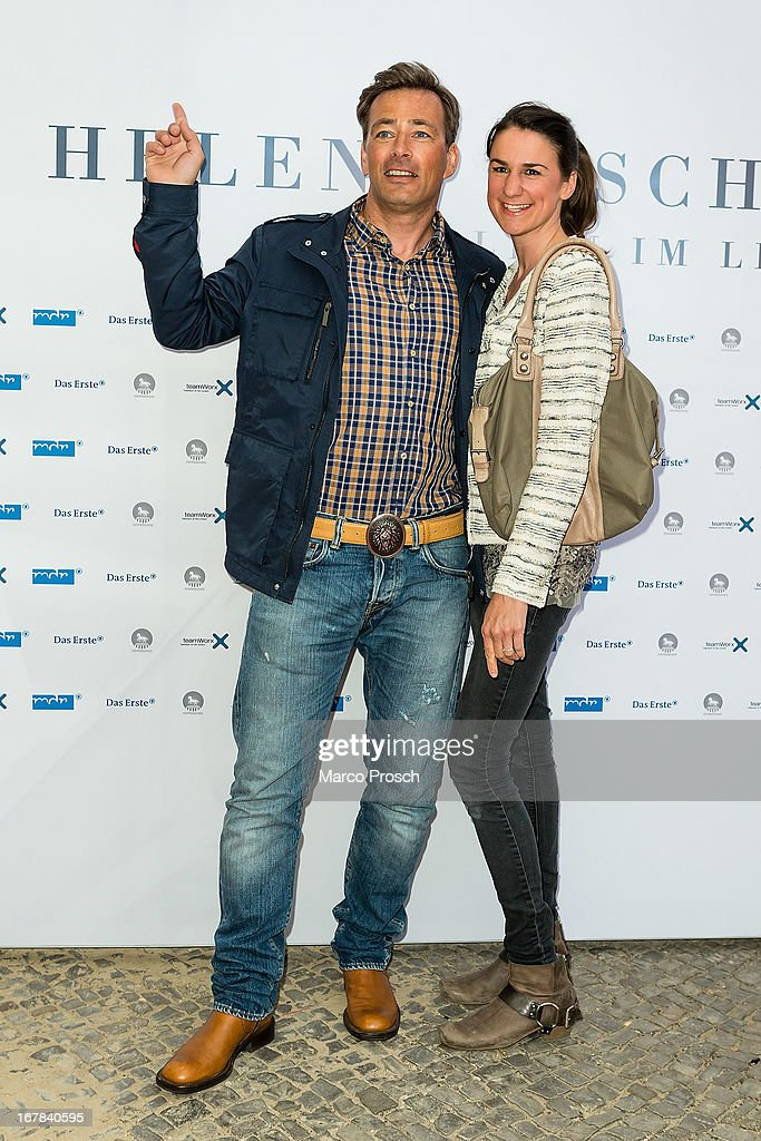 German actor Jan Sosniok (L) and girlfriend Nadine Moellers attend the premiere of the documentary 'Allein im Licht' ('Alone in the light') at the Babylon cinema on April 30, 2013 in Berlin, Germany.