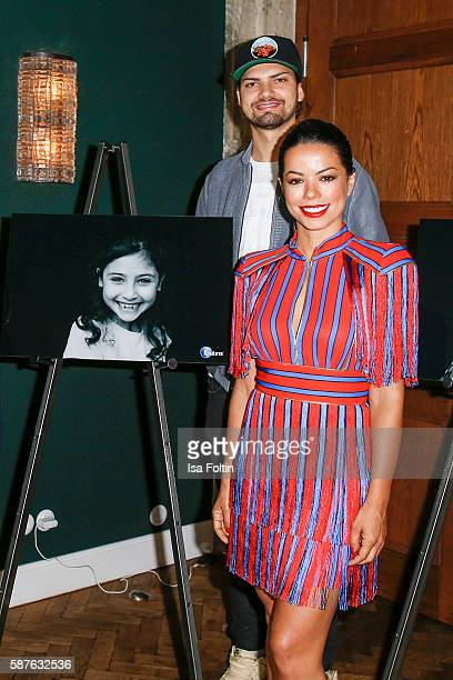 German actor Jimi Blue Ochsenknecht and brazilian singer Fernanda Brandao attend the photo exhibition 'Die Kunst des Kinderlaechelns' by Peter Badge...