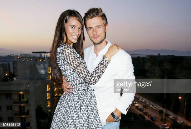 German actor Joern Schloenvoigt and his girlfriend Hanna Weig attend the Remus Lifestyle Night on August 3 2017 in Palma de Mallorca Spain