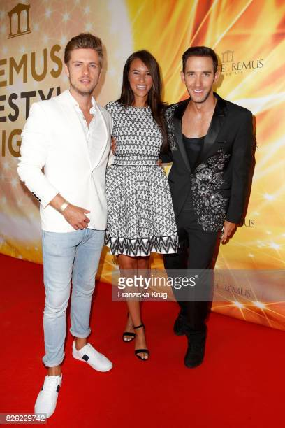 German actor Joern Schloenvoigt his girlfriend Hanna Weig and Marcel Remus attend the Remus Lifestyle Night on August 3 2017 in Palma de Mallorca...