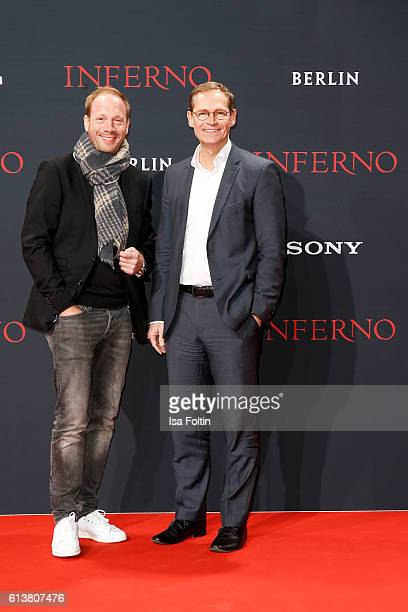 German actor Johann von Buehlow and mayor of Berlin Michael Mueller attend the German premiere of the film 'INFERNO' at Sony Centre on October 10...