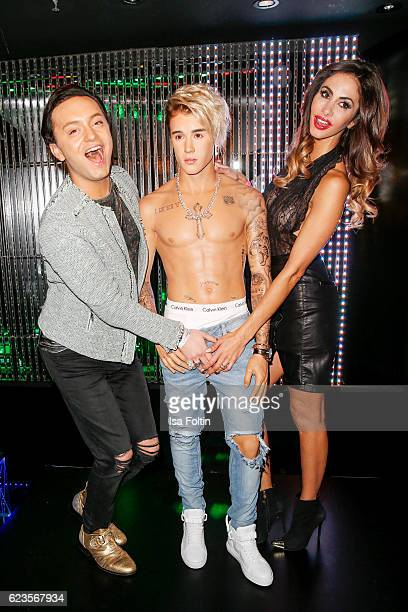 German actor Julian Stoeckel and model Janina Youssefian with Justin Bieber wax figure during the unveiling of the Justin Bieber wax figure at Madame...