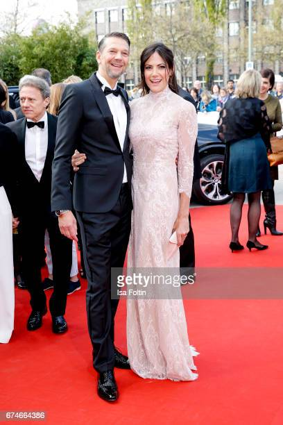 German actor Kai Wiesinger and his partner german actress Bettina Zimmermann during the Lola German Film Award red carpet arrivals at Messe Berlin on...