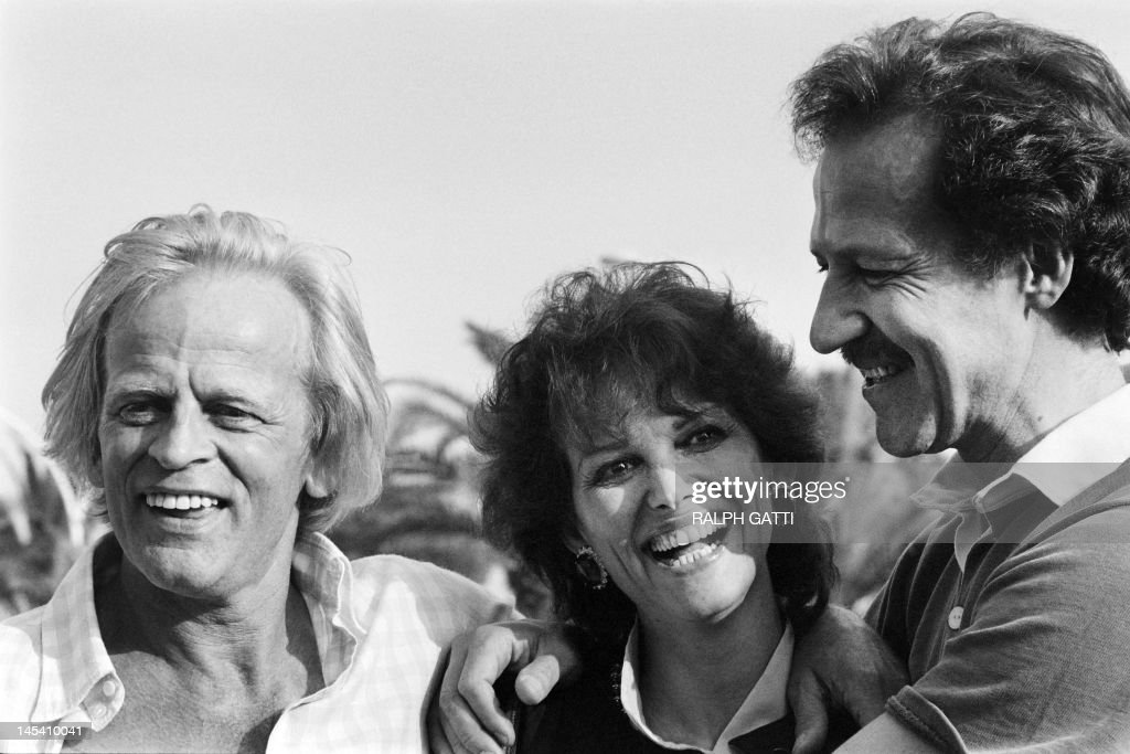 German actor Klaus Kinski, Italian actress Claudia Cardinale and German film director Werner Herzog pose during the photocall of 'Fitzcarraldo' during the 35th International Film Festival in Cannes, on May 21, 1982. AFP PHOTO RALPH GATTI