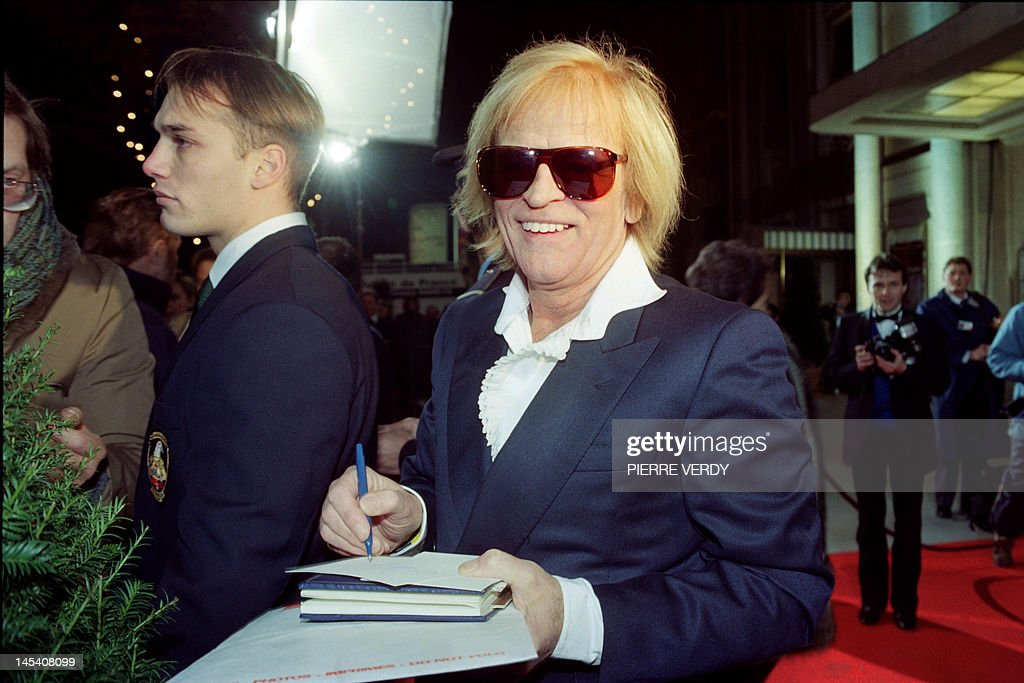 German actor Klaus Kinski signs autographs as he arrives at the European Film Awards ceremony in the Champs-Elysees Theater, on November 25, 1989.