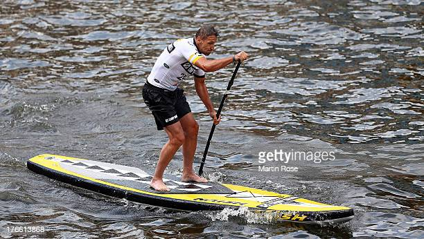 German actor Mark Keller competes during the Stand Up Paddling celebrity race at Magellan Terassen on August 16 2013 in Hamburg Germany
