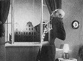 German actor Max Schreck as the vampire Count Orlok being destroyed by sunlight in a still from F W Murnau's expressionist horror film 'Nosferatu...