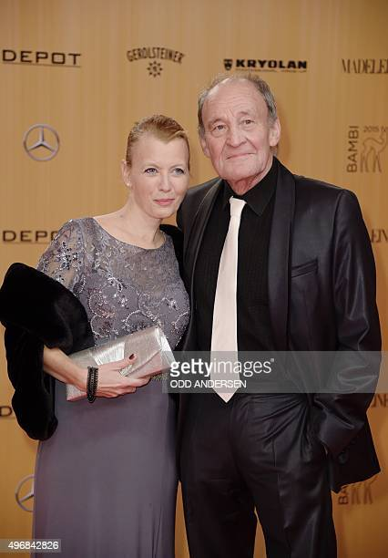 German actor Michael Mendl and Gesine Friedmann pose on the red carpet prior to the Bambi awards on November 12 2015 in Berlin The Bambis are the...