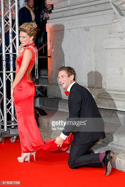 German actor Peer Kusmagk and his girlfriend Janni Hoenscheid attend the 'Sister Act The Musical' premiere at Stage Theater on October 16 2016 in...