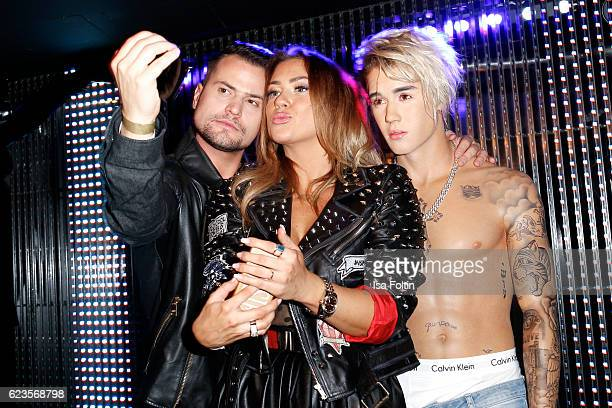 German actor Rocco Stark and his girlfriend model and musician Jessica Paszka with Justin Bieber wax figure during the unveiling of the Justin Bieber...