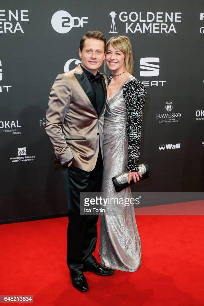 German actor Roman Knizka and his wife Stefanie Mensing arrive for the Goldene Kamera on March 4 2017 in Hamburg Germany