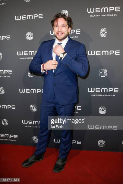 German actor Ronald Zehrfeld attends the Wempe store opening with the Rolls Royce shuttels in front of the store on February 23 2017 in Munich Germany