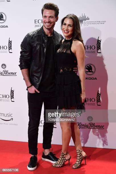 German actor Sebastian Pannek and his girlfriend CleaLacy Juhn arrive for the 2017 Echo Music Awards in Berlin on April 6 2017 / AFP PHOTO / Tobias...