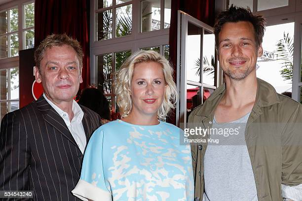 German actor Sylvester Groth german author Anika Decker and german actor Florian David Fitz during the 'Ein Herz fuer Kinder' summer party at...