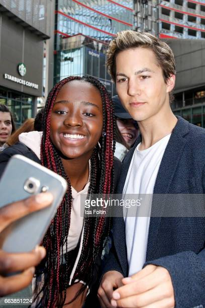 German actor Tim Oliver Schultz with a fan during the 'Die Schluempfe Das verlorene Dorf' premiere at Sony Centre on April 2 2017 in Berlin Germany