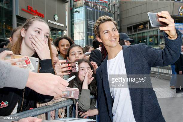 German actor Tim Oliver Schultz with fans during the 'Die Schluempfe Das verlorene Dorf' premiere at Sony Centre on April 2 2017 in Berlin Germany