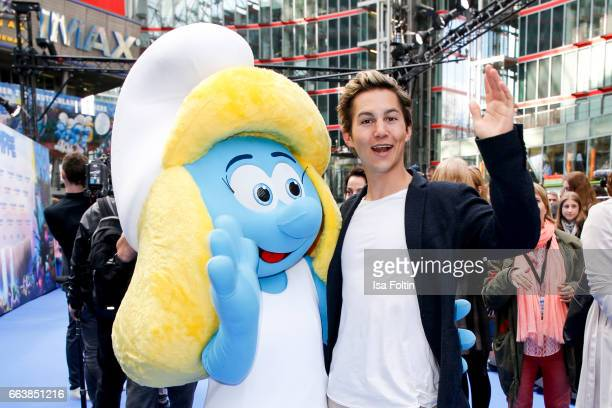 German actor Tim Oliver Schultz with smurf 'Schlumpfine' during the 'Die Schluempfe Das verlorene Dorf' premiere at Sony Centre on April 2 2017 in...