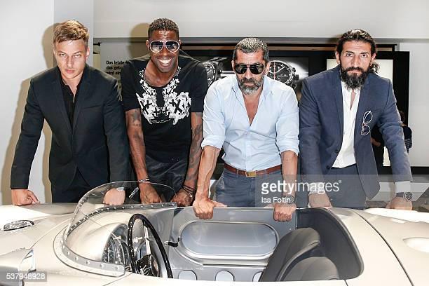 German actor Tom Wlaschiha suit shirt shoes belt and watch by Porsche Design football player Mohammadou Idrissou german actor Erdal Yildiz shirt...