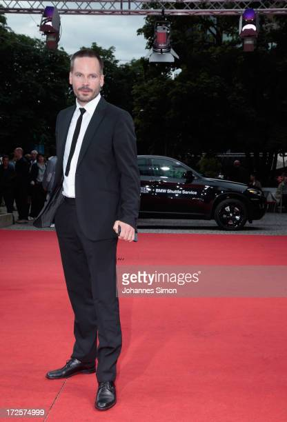 German actor Wanja Mues arrives for the 'Koenig von Deutschland' premiere at Gasteig on July 3 2013 in Munich Germany