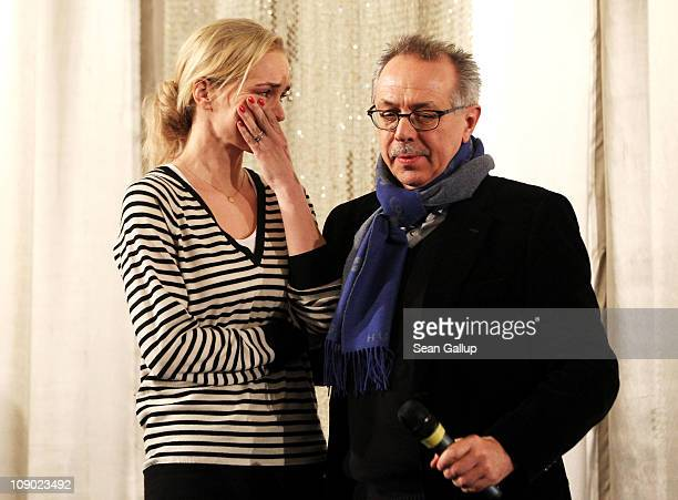 German actress and jury member Nina Hoss reacts next to festival director Dieter Kosslick during the Bernd Eichinger Memorial Screening during day...