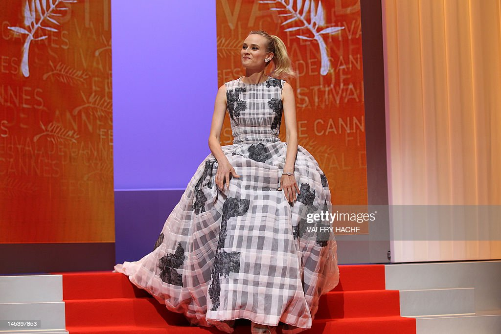 German actress and member of the Jury, Diane Kruger smiles as she arrives on stage during the closing ceremony of the 65th Cannes film festival on May 27, 2012 in Cannes. AFP PHOTO / VALERY HACHE