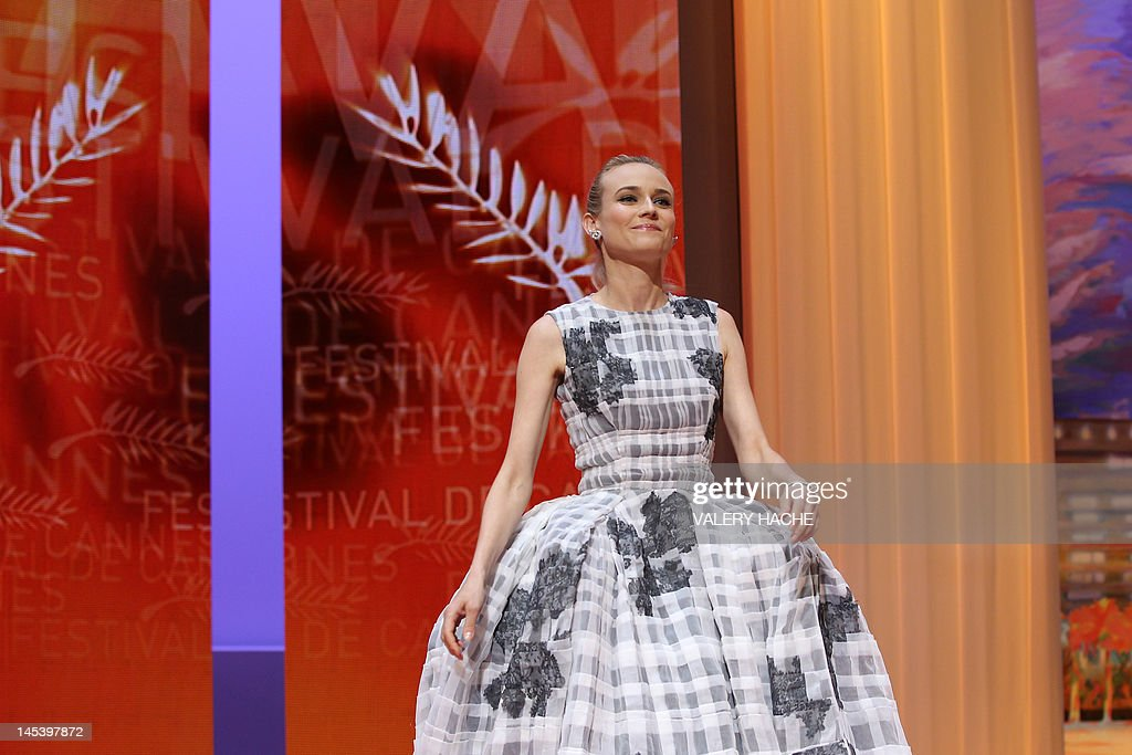 German actress and member of the Jury Diane Kruger smiles as she arrives on stage during the closing ceremony of the 65th Cannes film festival on May 27, 2012 in Cannes. AFP PHOTO / VALERY HACHE