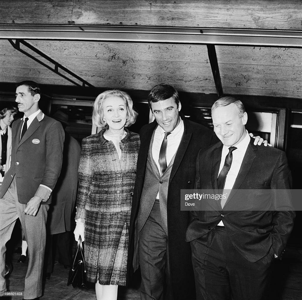 German actress and singer Marlene Dietrich (1901 - 1992) at London Airport, to welcome American composer Burt Bacharach (centre) to the UK, 21st November 1964.