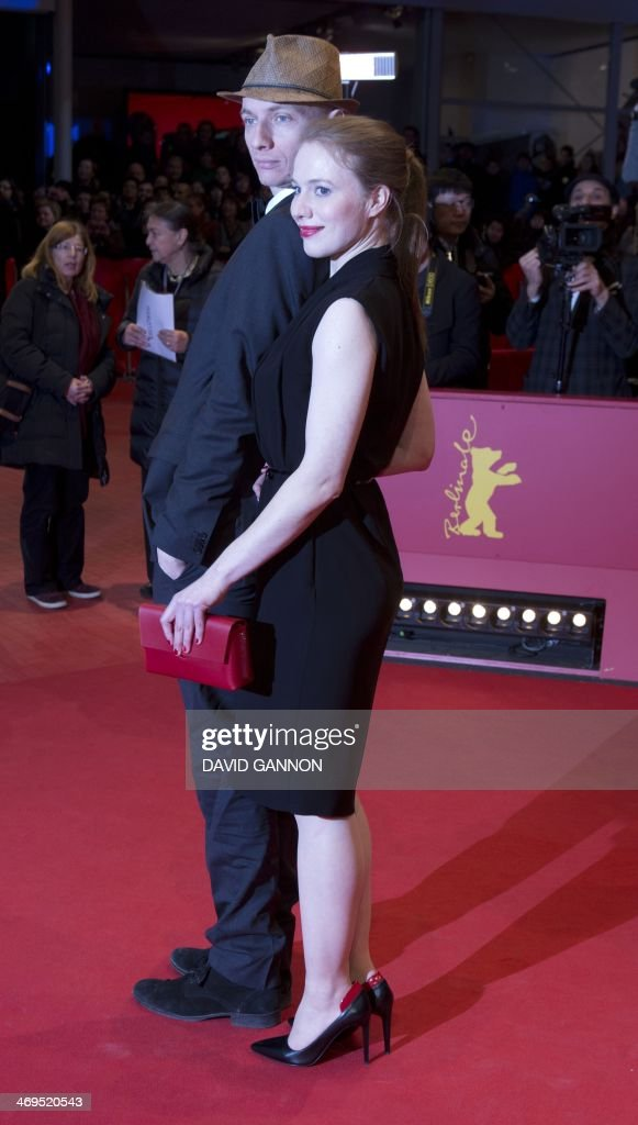 German actress Anna Brueggemann (R) and her brother, director and screenwriter Dietrich Brueggemann arrive on the red carpet for the awarding ceremony of the 64th Berlinale Film Festival in Berlin, on February 15, 2014. The 64th Berlinale, the first major European film festival of the year, takes place from February 6 to 16, 2014 with 24 international productions screening in the main showcase.