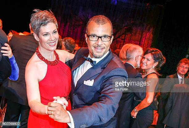 German actress Cheryl Shepard and her husband Nikolaus Okonkwo dance during the Leipzig Opera Ball 2016 on September 10 2016 in Leipzig Germany