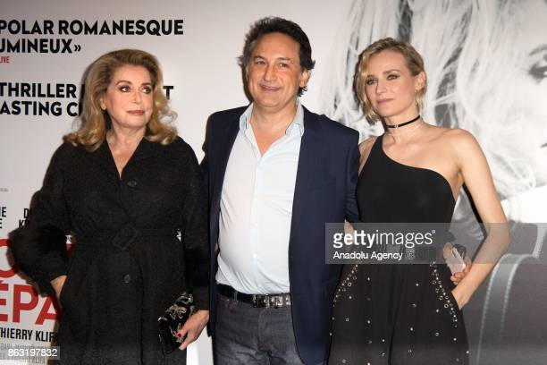 German actress Diane Kruger French actress Catherine Deneuve and movie director Thierry Klifa attend the premiere for 'All That Divides Us' movie at...
