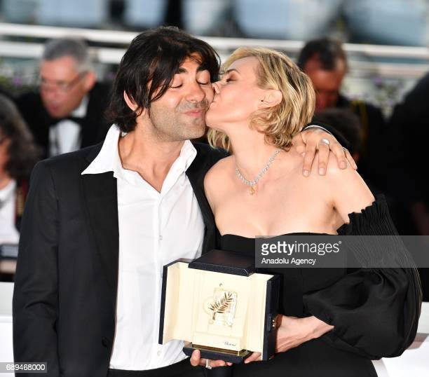 German actress Diane Kruger kisses her director Fatih Akin during the Award Winners photocall after she won the Best Actress Prize for Aus dem Nichts...