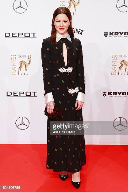German actress Hannah Herzsprung poses on the red carpet for photographers as she arrives at the Bambi awards on November 17 2016 in Berlin The...