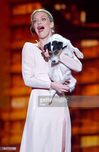 German actress Heike Makatsch holds a jack russell terrier during the 24th European Film Awards ceremony on December 3 2011 in Berlin Germany